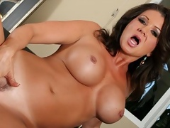 Sexy MILF with big tits shows off her cock handling talents