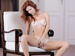 Redhead beauty Mia Sollis posing so hot on the chair