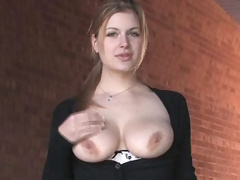 Danielle plays with her huge boobs outside